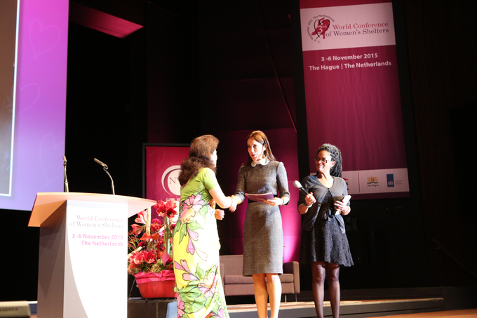 Chair of GNWS Bandana Rana presents the first copy of the Global Shelter Data Count report 2014-2015 to Crown Princess Mary of Denmark